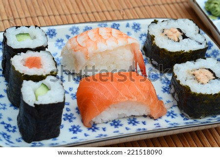 Beautiful Asian Sushi decorated with nice kitchenware and tableware  - stock photo