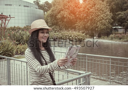 Beautiful asian woman and book in modern vintage concept
