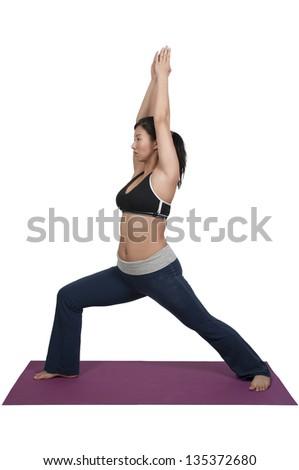 Beautiful Asian woman doing her Yoga exercises - stock photo
