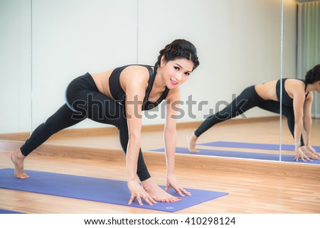 Beautiful asian woman doing yoga exercise