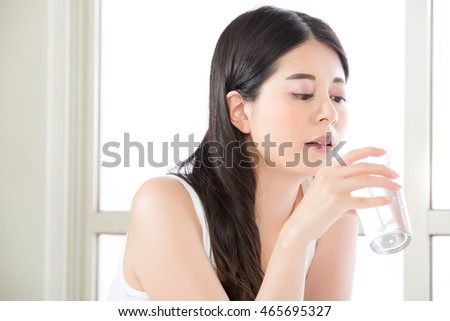beautiful asian woman drinking clean water for healthy lifestyle