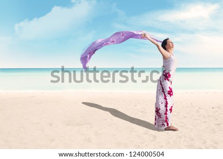 Beautiful asian woman enjoying beautiful day at the beach