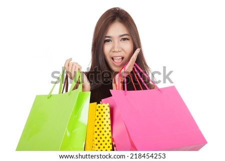Beautiful Asian woman  excited with  shopping bags in both hands  isolated on white background
