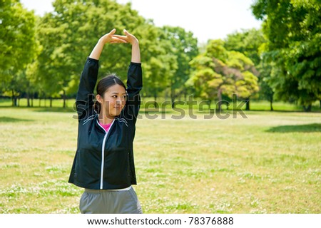 beautiful asian woman exercising in the park - stock photo