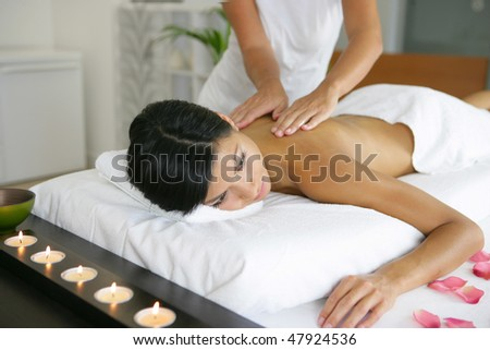 Beautiful asian woman having a massage - stock photo