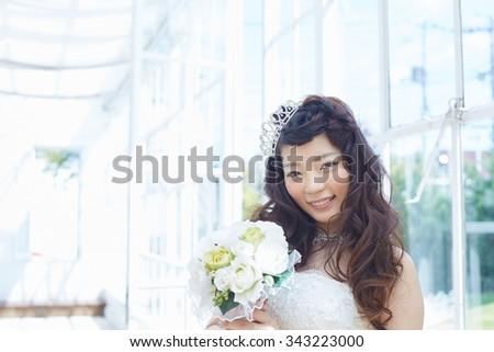 Beautiful asian woman in elegant wedding dress - stock photo