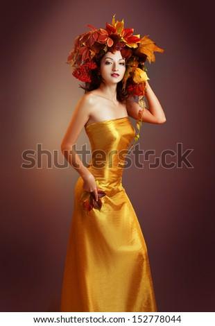 beautiful asian woman in golden dress. Quin autumn - stock photo