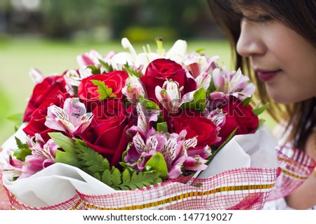 Beautiful Asian woman in love holding flower bouquet.