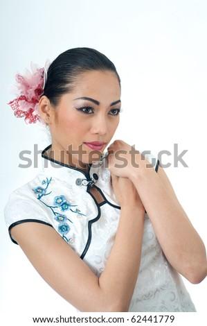 Beautiful Asian woman in Qipao dress - stock photo