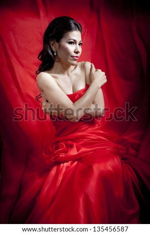 Beautiful asian woman in red dress