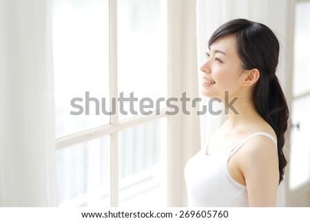 Beautiful asian woman in the bathroom - stock photo