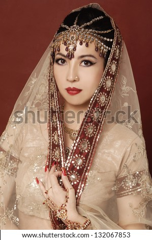 Beautiful asian woman in traditional clothing with bridal makeup and jewelry.