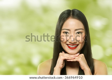Beautiful asian woman over blur background