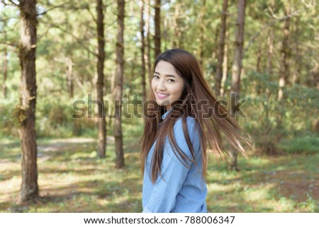 Beautiful asian woman portrait in the forrest,Phu Rua mountain,Loei,Thailand.
