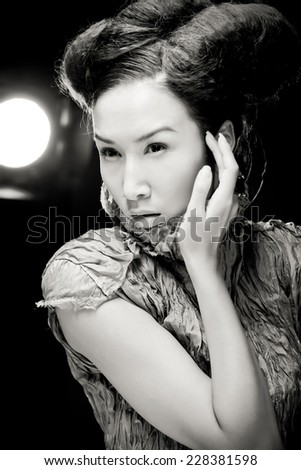Beautiful asian woman  pose in studio. Vogue style photo.