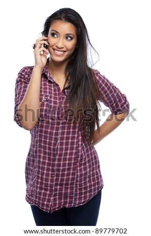 beautiful asian woman posing with cellphone in studio - stock photo