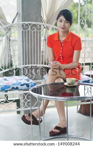 Beautiful Asian woman relax in coffee shop. - stock photo