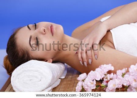 beautiful Asian woman relaxes at the spa - stock photo