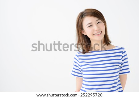 Beautiful asian woman relaxing on white background