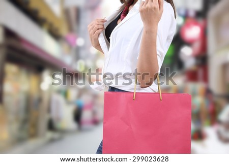 beautiful asian woman shopping and holding bag on her hand