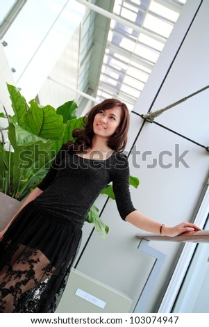 Beautiful asian woman smiling in modern building