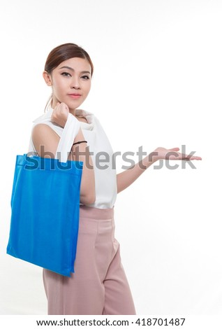 Beautiful Asian woman standing , holding shopping bag.