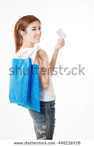 Beautiful asian woman standing , holding shopping bag and card.