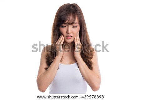 Beautiful asian woman suffering from toothache on white background - stock photo
