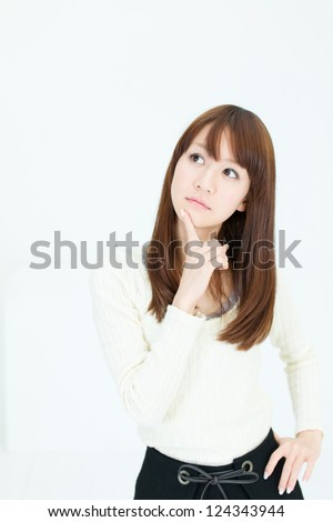 Beautiful asian woman thinking - stock photo