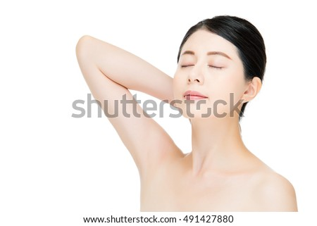 Beautiful asian woman touch her face with fashion motion, isolated on white background
