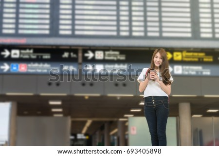 young woman international airport looking flight stock photo 402702424 shutterstock. Black Bedroom Furniture Sets. Home Design Ideas