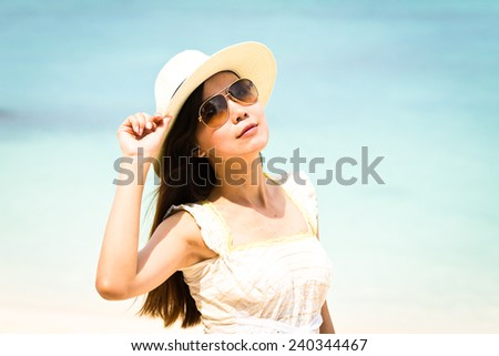 Beautiful asian woman vacation on beach of Thailand.