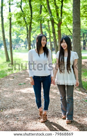 beautiful asian woman walking in the forest - stock photo