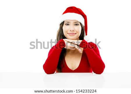 Beautiful asian woman with a beautiful smile wearing Santa's hat,  isolated on white