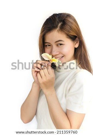 Beautiful asian woman with a Plumeria flower on white background.