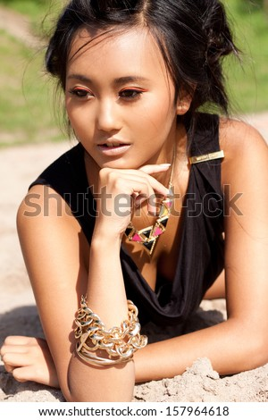 beautiful asian woman with colorful makeup on the beach portrait summer beauty