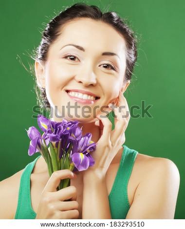 Beautiful asian woman with flower iris - stock photo