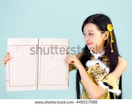 beautiful Asian woman with gesture / happy chinese new year - stock photo