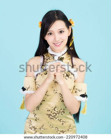 beautiful Asian woman with gesture of congratulation, happy Chin - stock photo