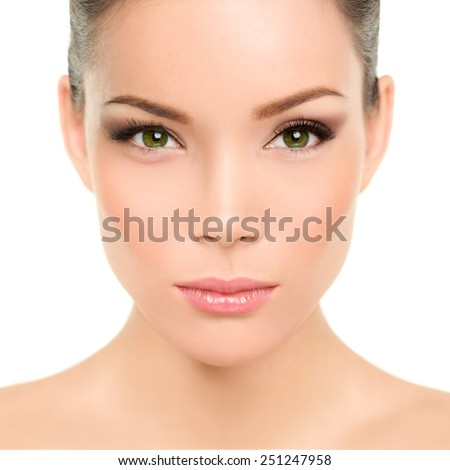 Beautiful asian woman with green eyes and perfect beauty makeup. Mixed race chinese caucasian young girl with green eyes cosmetic concept. Perfect features and skin. - stock photo