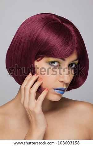 Beautiful asian woman with red hair on grey background - stock photo