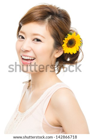Beautiful asian woman with sunflower - stock photo