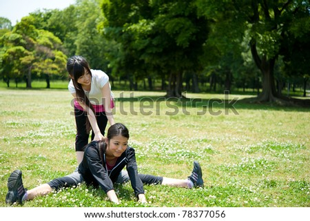 beautiful asian women exercising in the park - stock photo