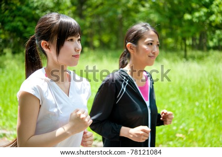 beautiful asian women jogging in the park - stock photo