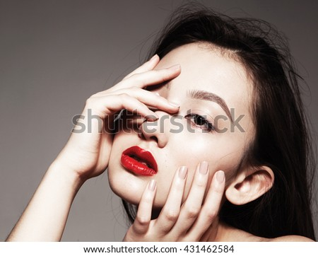 Beautiful asian young model with red lips and natural  manicure, fashion model