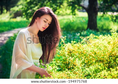 Beautiful asian young woman resting on nature