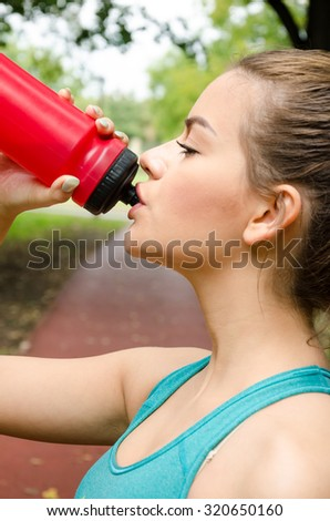 beautiful athletes drinks water - stock photo