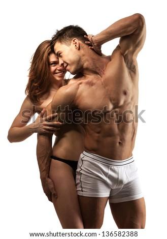 Beautiful athletic couple over white - stock photo