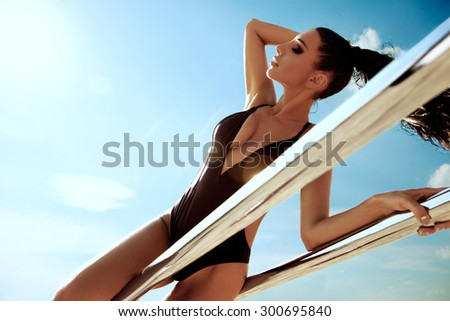 Beautiful athletic girl in action - stock photo