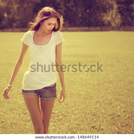 beautiful athletic girl on the field - stock photo